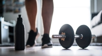 Walking-Around-Living-Room-With-A-Dumbbell-On-The-Floor