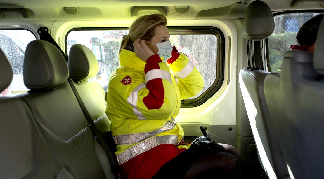 Woman-Coronavirus-Responder-Putting-On-Face-Mask