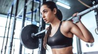 Young Fit Female Strongly Focused Barbell Squat