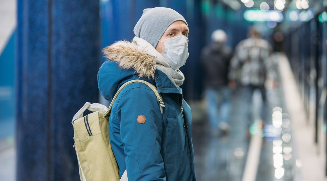 Young-Male-Student-Wearing-Medical-Mask-Waiting-For-Subway