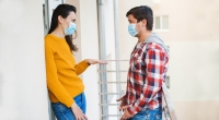 Couple-Wearing-Masks-talking-outside-an-apartment-During-Covid19-Pandemic-