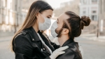 Hip couple wearing face masks under covid-19 pandemic