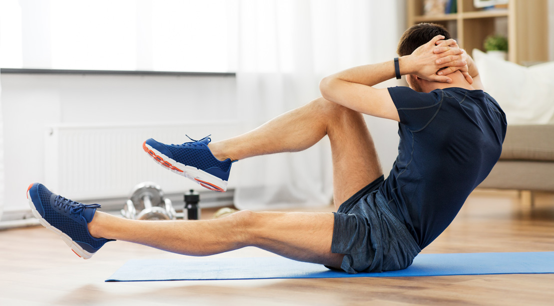 Man-Doing-Crunches-At-Home