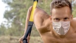 Man-Working-Out-With-TRX-Bands-Outdoor-during-Covid-19-Pandemic