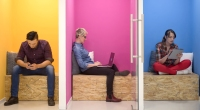 People working in different colored rooms