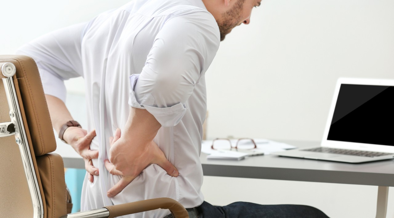 Man Working From Home Back Pain