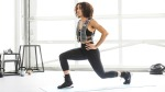 Female wearing a weighted vest while doing lunge exercise