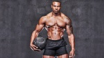 Fitness-Model-Simeon-Holding-A-Medicine-Ball