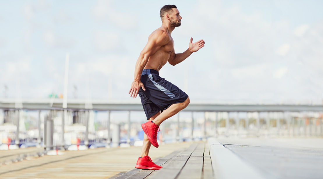 Man working out outdoors with HIIT