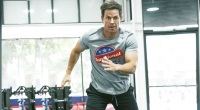 Fit celebrity Mark Wahlberg working out with an exercise at F45