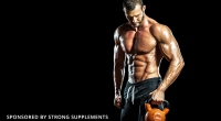 Muscular-Shirtless-Bodybuilder-Holding-A-Kettlebell
