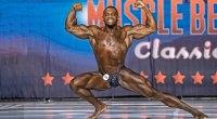 NPC bodybuilder Everett Jolivet posing on bodybuilding stage