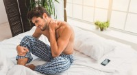 Man in Bed with Neck Pain