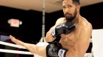 Actor Neil Brown Jr stretching his legs in a boxing ring