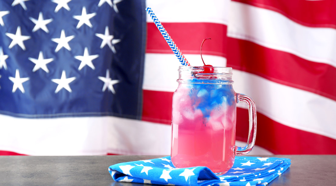 The American Flag and July 4th inspired cocktail in a mason jar