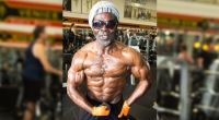 Bodybuilder over 40 years old Robby Robinson posing and flexing in the gym