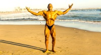 Bodybuilder over 40 years old Tony Pearson posing on the beach