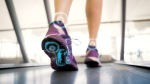 Female wearing advanced running shoes on a treadmill