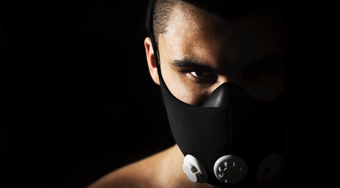 Focused man wearing a high altitude training mask