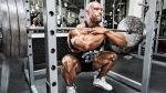 Professional bodybuiler Juan Morel doing a front squat exercise at a squat rack