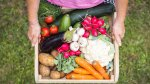 Man-Holding-A-Wooden-Box-Of-Fresh-Produce