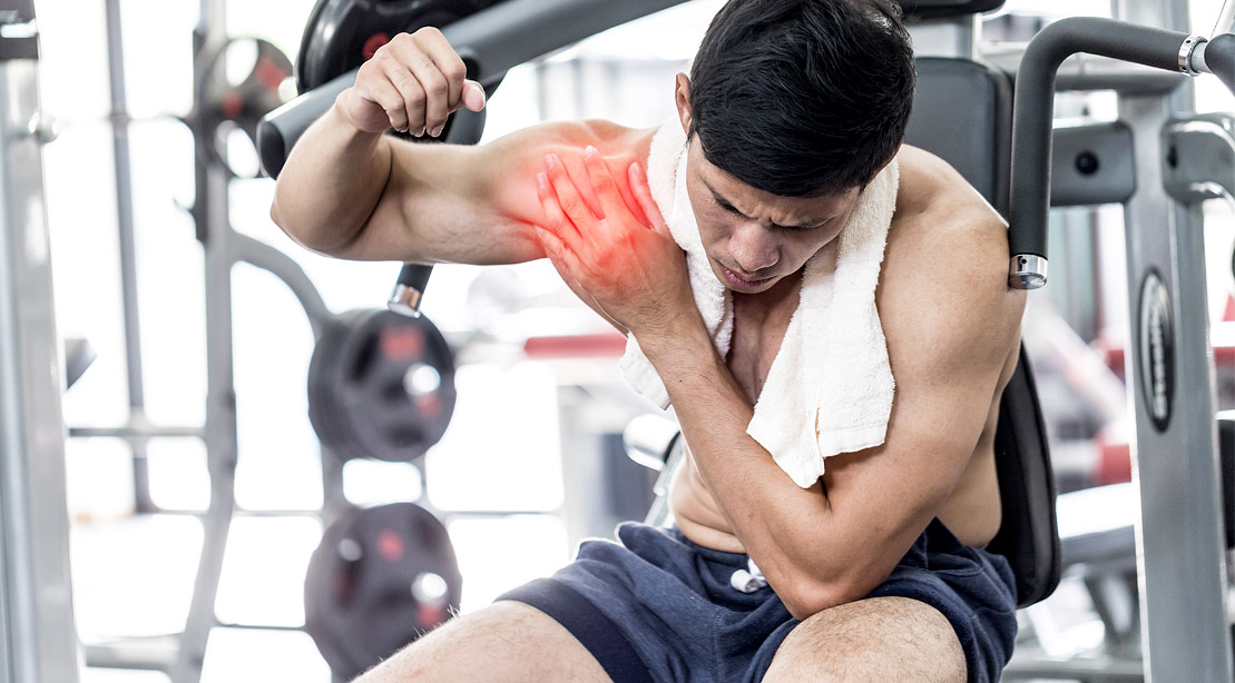 Man working out a muscle strain with inflammation in the shoulder from a shoulder injury