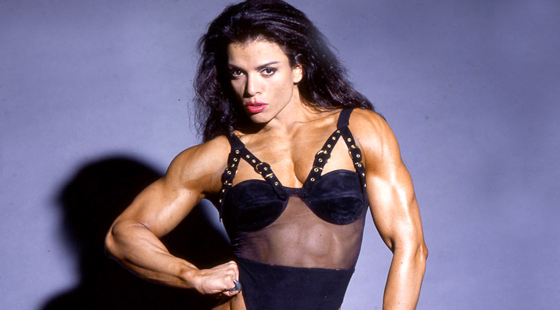 Muscular woman and female bodybuilder Sharon Bruneau modeling an black outfit