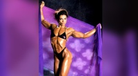 Muscular-Woman-Sharon-Bruneau-Holding-A-Purple-Blanket