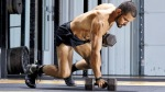 Onnit trainer Eric Leija doing dumbbell flow workouts