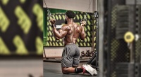 Osamoj-Imoohi-Performing-Step-2-Of-A-Kneeling-Cable-Pulldown-Exercise
