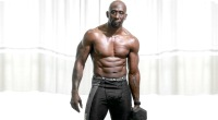 Funk Roberts bodybuilder holding a dumbbell