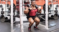 Professional bodybuilder Roelly Winklar doing squats with a duffalo bar