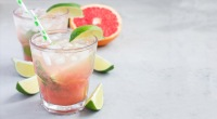 Sparkling grapefruit mint cocktail with a lime garnish