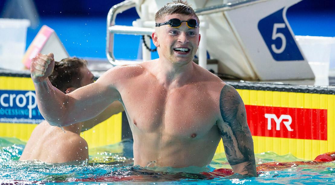 Olympic swimmer Adam Peaty celebrating his win in an olympic swimming pool