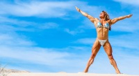 Muscular woman and professional female bodybuilder Helle Trevino posing in Death Valley