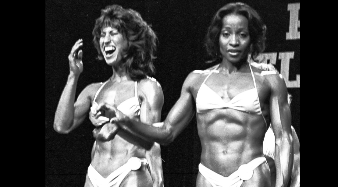 Ms. Olympia Rachael McLish and female bodybuilder runner up Carla Dunlap at the Ms Olympia competition 1982