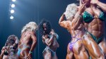 Muscular women and female bodybuilders competing and a bodybuilding competition