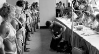 Female bodybuilders in the 70's lining up to be judged in a female bodybuilding competition
