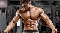 Muscular fitness model with a six pack and muscular forearms