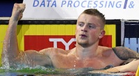 Olympic Gold Medal Swimmer Adam Peaty in an olympic swimming pool looking strong
