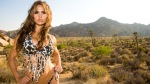 Muscular Woman and Bodybuilder Timea Majorova wearing snake skin bikini at Joshua Tree landscape