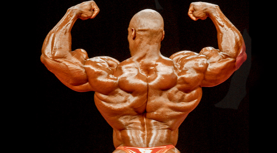 Bodybuilder Nasser El Sonbaty showing his back muscle definition in his middle back muscles