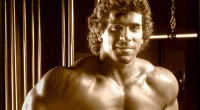 Lou Ferrigno the original actor who played the Hulk posing in a gym