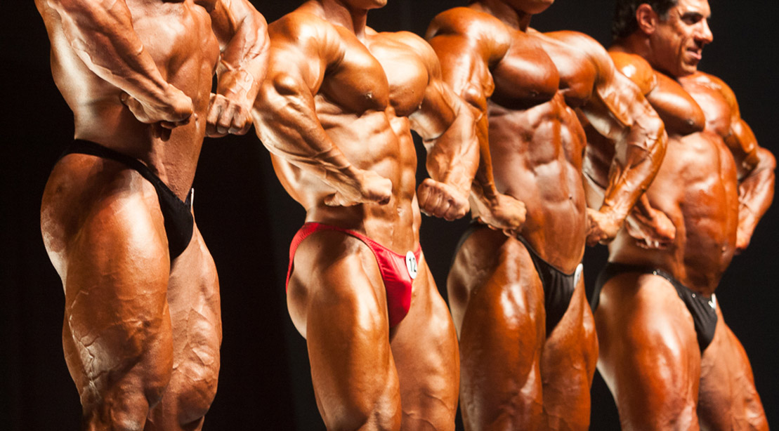 Bodybuilders line up at bodybuilding competition