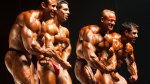 Bodybuilders posing in a bodybuilding competition