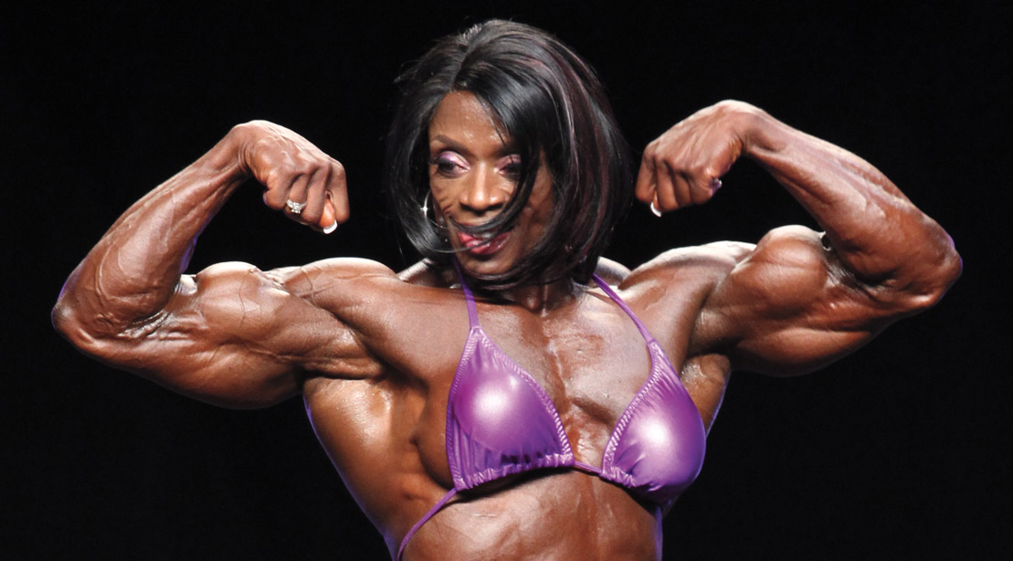 Female bodybuilder Iris kyle competing in a bodybuilding competition