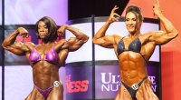 Female bodybuilder Iris Kyle and Alina Popa competing on stage at a bodybuilding competition