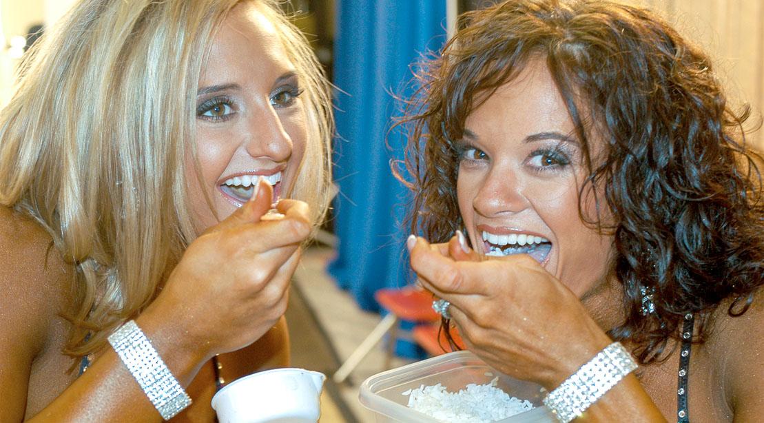 Female bodybuilder eating white rice