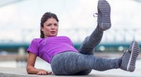 Female-Fitness-Model-Doing-Ab-Workouts-With-Scissor-Crunches