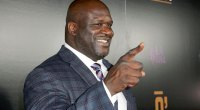 Former NBA basketball player for the LA Lakers Shaquille O'Neal pointing in a suit